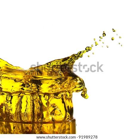 splash of yellow  juice in white