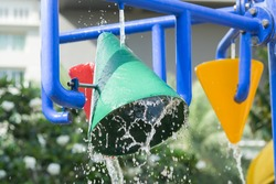 Splash pad or sprayground in water park for kids.