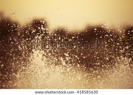 Splash water between sunset #418585630