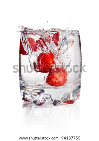 splash water in glass with strawberry isolated on white background