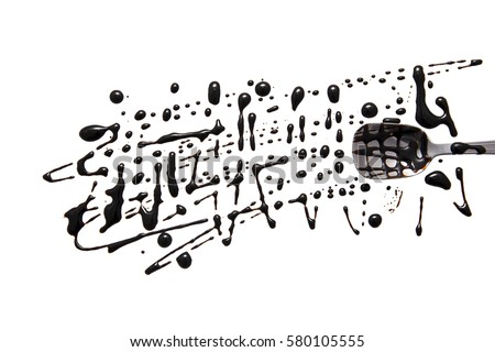splashes and spilled balsamic vinegar with a spoon. isolated on white background. flat lay, top view