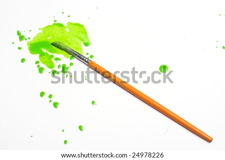 splashes of green paint and brush