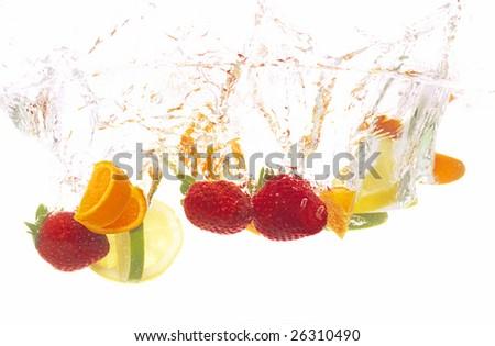splashing fresh fruits into water