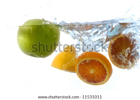 splashing fruit -  against white