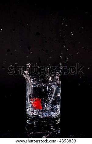 Splashing transparent liquid in a glass
