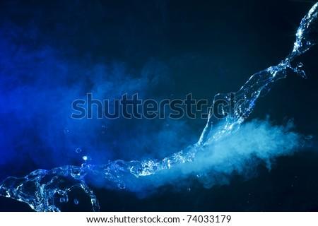 Splashing water on black background - stock photo