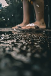 splashing water on the street when the children stepped on.street, water, rain, wet, splash, weather, city, drop, puddle, summer, splashing, urban, storm, day, motion, outdoors, nature, outdoor, road,