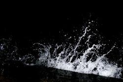 Splashing wave on the Black sea in the night.