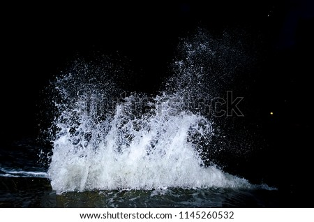 Splashing wave on the Black sea in the night.