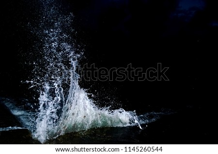Splashing wave on the Black sea in the night. #1145260544