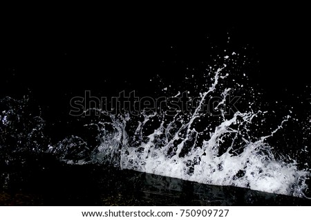 Splashing wave on the Black sea in the night. #750909727