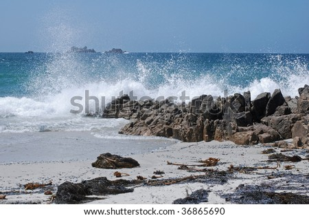 splashing waves and blue ocean and sky in sunny Brittany