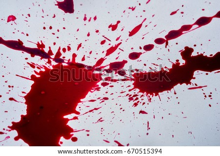 splatters of fresh human bright red blood on a concrete surface ez