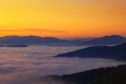 splendid foggy morning panoramic wiew, scenic summer nature image of Carpathian mountains, spectacular scenery of valeey covered mist under golden sunrise, Ukraine, Europe, Carpathians