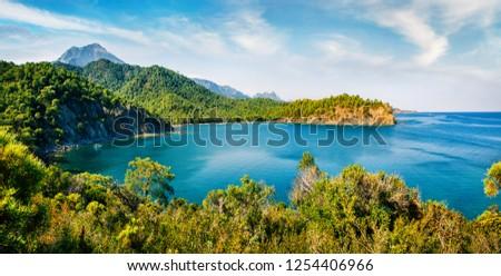 Splendid Mediterranean seascape of Mediterranean sea. Panoramic summer view of a small azure bay near the Tekirova village vith Mt. Tahtali on background. Beauty of nature concept background. #1254406966