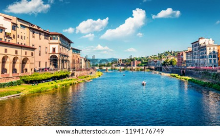 Splendid morning scene with Ponte alle Grazie bridge over Arno river. Colorful spring view of Florence, Italy, Europe. Traveling concept background.