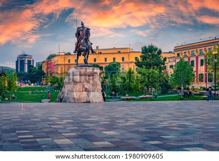 Splendid spring view of monument of Skanderbeg in Scanderbeg Square. Picturesque sunset in capital of Albania - Tirana. Traveling concept background.
