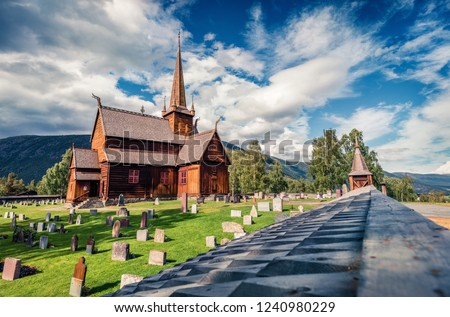 Splendid summer view of Lom stave church (Lom Stavkyrkje). Sunny morning scene of Norwegian countryside, administrative centre of Lom municipality - Fossbergom, Norway, Europe. Stock fotó ©