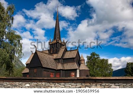 Splendid summery view of Lom stave church (Lom Stavkyrkje). Sunny day scene of countryside in Norway. Lom, Norway, Europe Stock fotó ©