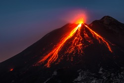 Splendid view Etna ruption at sunset, Sicily. Wonderful colors, lava flow red