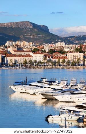 Split cityscape by the Adriatic Sea in Croatia, Dalmatia region, luxury yachts marina in the foreground.
