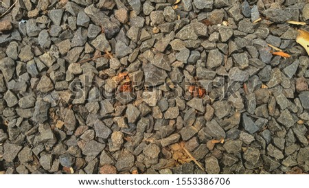 Split rock is a building material that is obtained from splitting or breaking large stones into small pieces. Suitable for use as photographic editing materials.