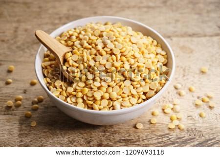 split soybean in bowl on wooden background #1209693118