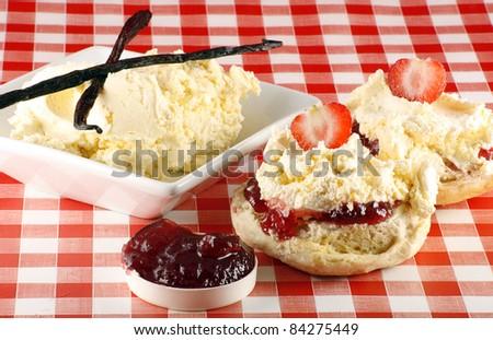 split strawberry cream scone, with cream and jam