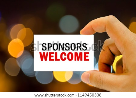 sponsors welcome written on business card man hand holding