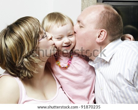 Spontaneous affectionate young family