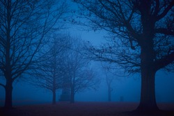 Spooky battlefield in Gettysburg, PA in silhouette with mist and fog