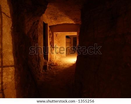 Spooky catacomb - stock photo