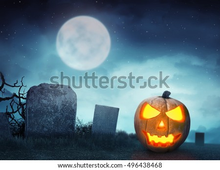 Spooky cemetery with glow halloween pumpkin in the night #496438468