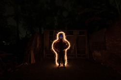 spooky dolls decorated with light paintings in the dark night