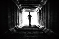 Spooky figure at the end of the dark tunnel. Life after death