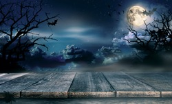 Spooky halloween background with empty wooden planks, dark horror background. Celebration theme, copyspace for text. Ideal for product placement