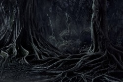 Spooky Halloween dead mysterious forest creepy trees with twisted roots and two lizard on misty night forest. Scary concept.