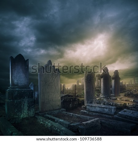 Spooky Halloween graveyard with dark clouds