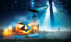 Spooky halloween pumpkin on wooden planks with dark horror background. Celebration theme, copyspace for text.