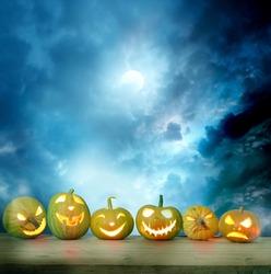 Spooky halloween pumpkins on a wooden table
