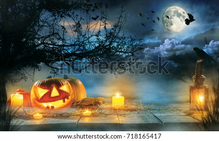 Spooky halloween pumpkins on wooden planks with dark horror background. Celebration theme, copyspace for text. #718165417