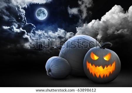 spooky halloween pumpkins under full moon #63898612
