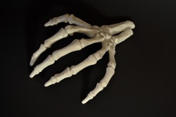 Spooky Halloween severed skeletal hand reaching out
