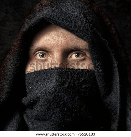Stock Photo Spooky man in black hood