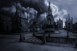 Spooky moonlit old european cemetery in a cloudy night with mysterious stairs in the foreground