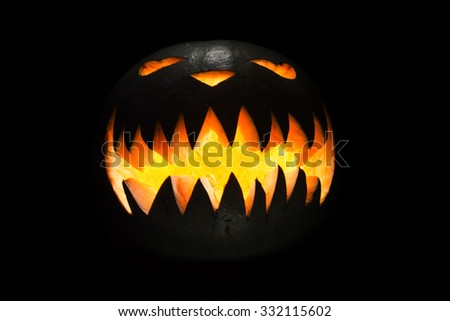 Spooky pumpkin in dark, isolated on black background