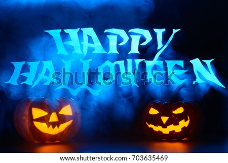 Spooky pumpkin lanterns decoration with happy Halloween words
