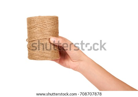 Spool of bale twine isolated in hand on white background