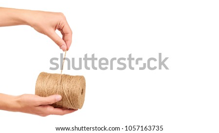 Spool of bale twine isolated in hand on white background. copy space, template.