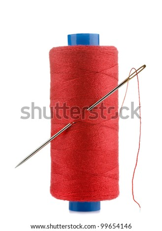 Spool of red thread and needle isolated on white
